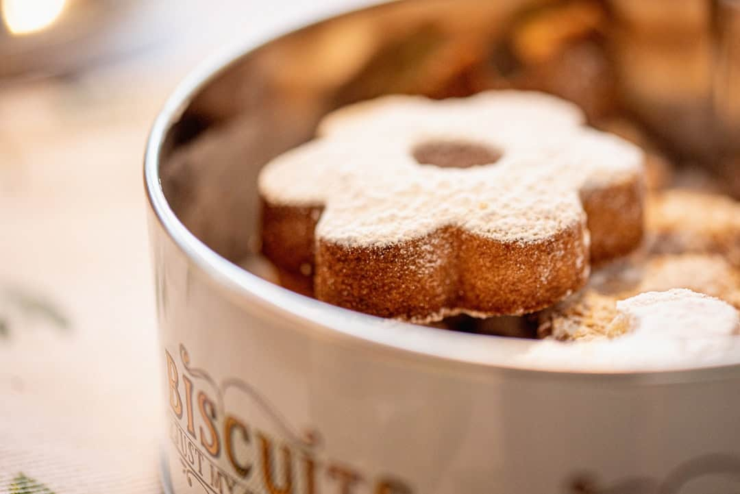 A close up of a doughnut and a cup of coffee