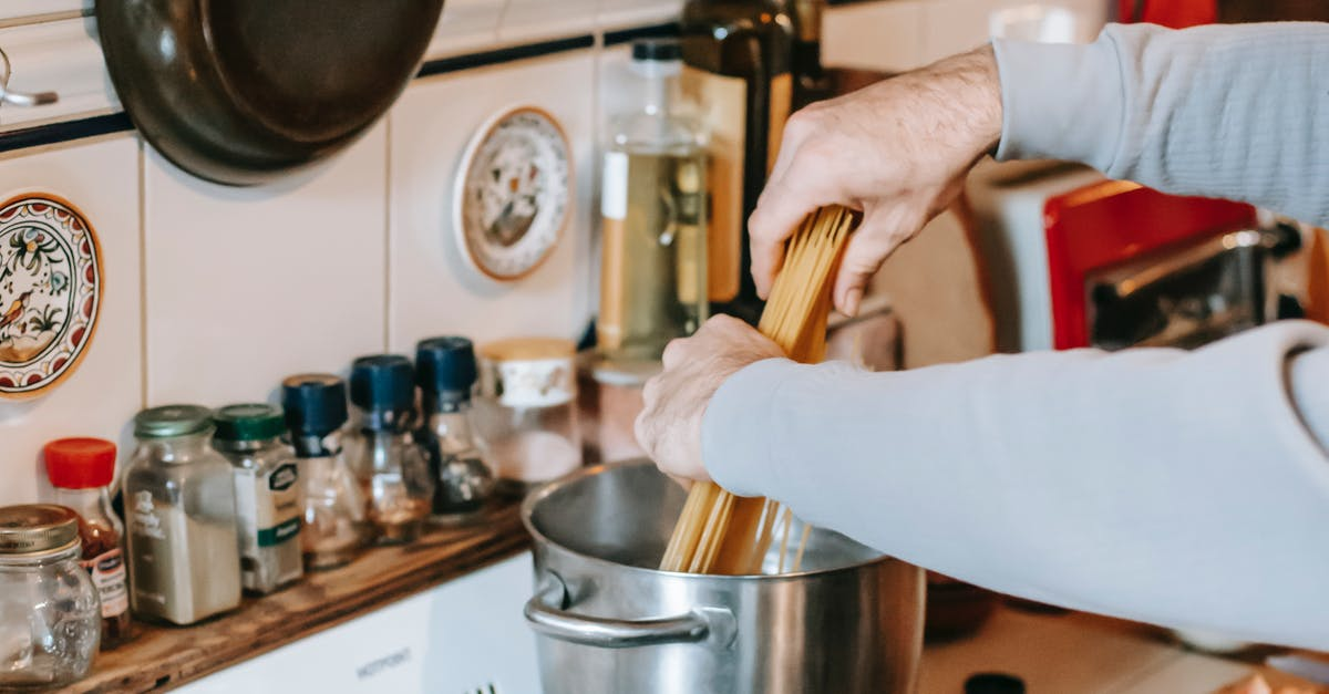 A person in a kitchen preparing food